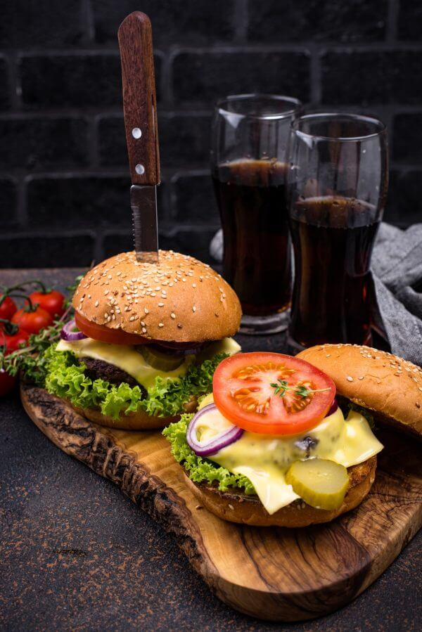 Burger and cheeseburger with tomato