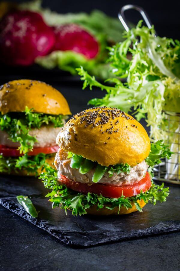 Colored yellow burgers. Chicken burgers hamburgers with turmeric bread